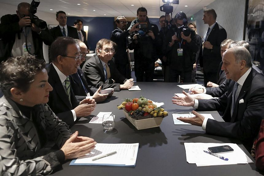 French Foreign Minister Laurent Fabius, President-designate of COP21, talks to United Nations Secretary General Ban Ki-moon and Executive Secretary of the UN Framework Convention on Climate Change Christiana Figueres.