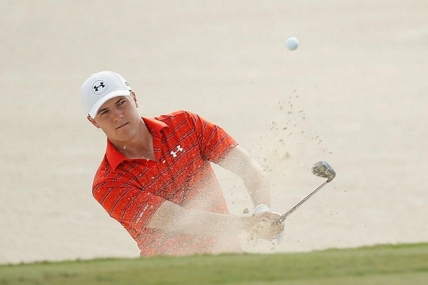 Jordan Spieth of the United States plays a bunker shot on the third hole during the third round of the Hero World Challenge at Albany.
