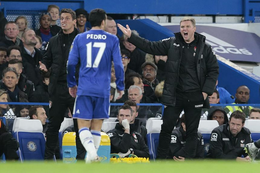 Bournemouth manager Eddie Howe (right) reacts during the English Premier League match against Chelsea.