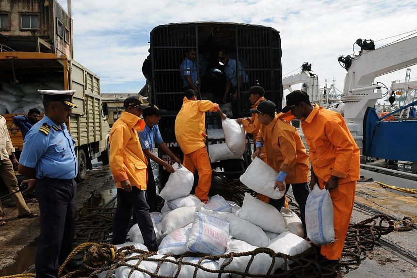 Indian relief workers load supplies for flood victims in Chennai on Dec 5, 2015.