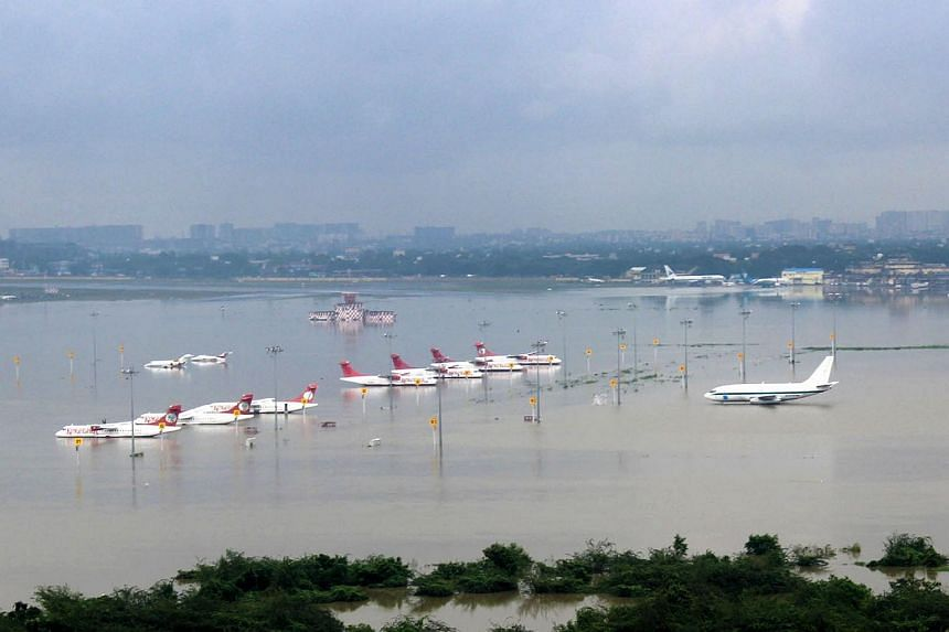 This photograph released by the Press Information Bureau on Dec 2, 2015, shows an aerial view of the submerged Chennai airport taken from an Indian Air Force helicopter.