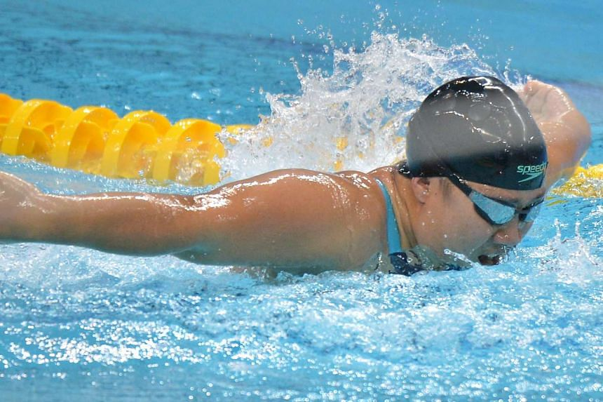 Singapore swimmer Theresa Goh swimming her way to victory in the Women's 50m Butterfly event.
