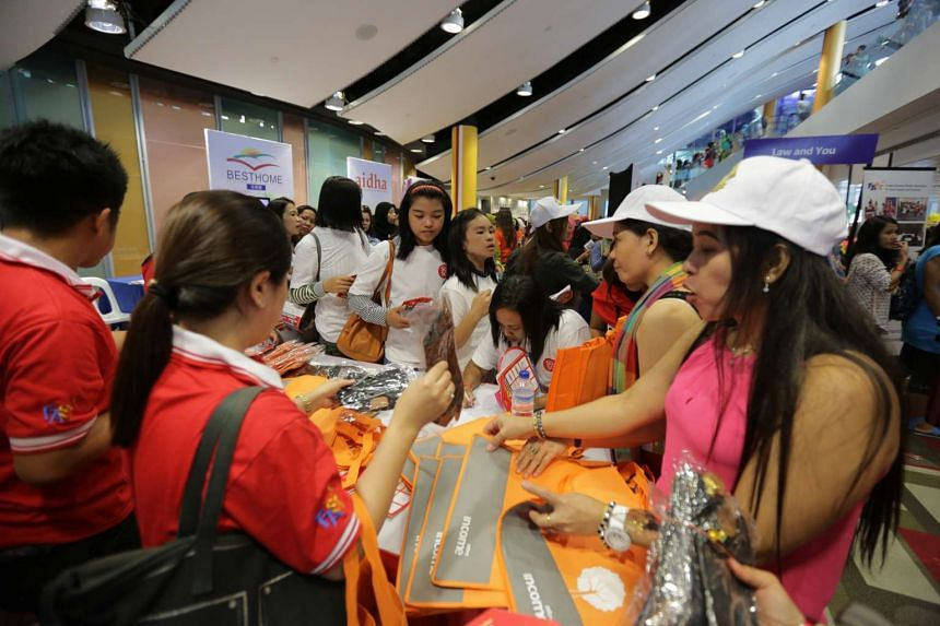Domestic workers and employers mingling at the 6th annual Foreign Domestic Worker Day, at the Singapore Polytechnic Convention Centre on Dec 6, 2015.