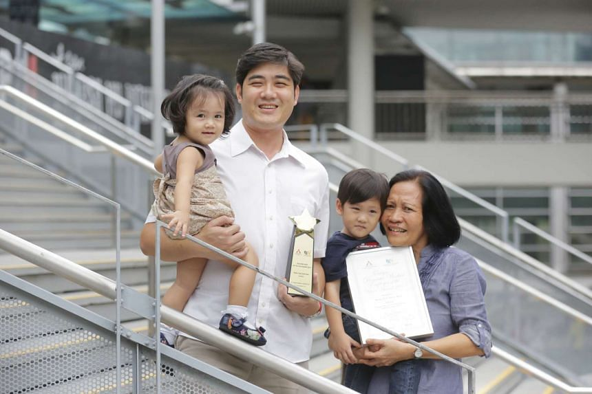 Domestic helper Marny C. Pera (right) with Mr Ling Wei Hong, the son of Ms Pera's employer Yap Sock Hoe, who won FDW Employer of the Year. With them are Mr Ling's daughter Allegra and son Kaius.