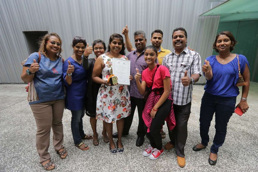 Foreign Domestic Worker of the Year winner Ranpati Dewage Siyanthi Siromani Pushpika (centre), with employers Selvakumari Chelladurai (third from left) and Balan Arunasalam (centre, in purple) and their friends.