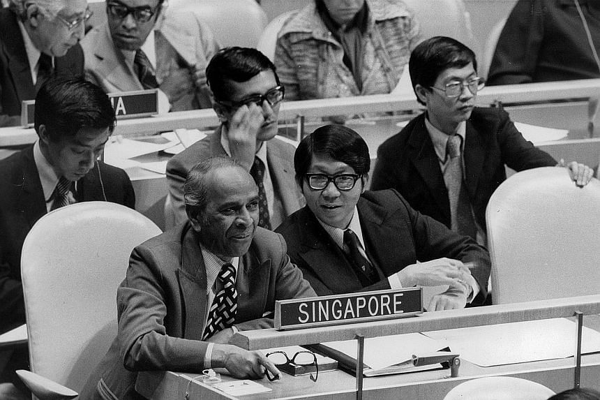 Minister for Foreign Affairs S. Rajaratnam (left) with Ambassador Tommy Koh, Permanent Representative to the United Nations, at the UN General Assembly in New York on Sept 30, 1974. Behind them are Singapore delegates Michael Cheok (partly hidden), L