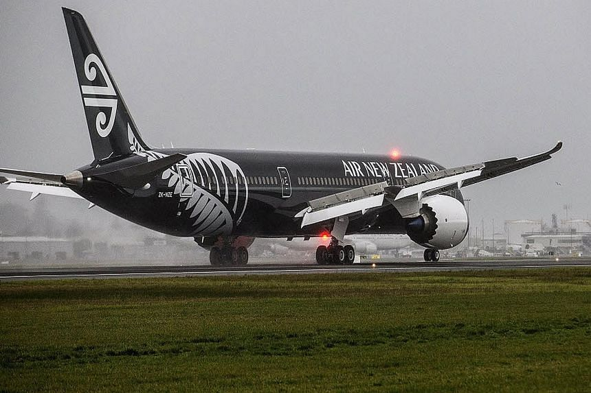 An Air New Zealand plane designed with the New Zealand All Blacks rugby team colours.