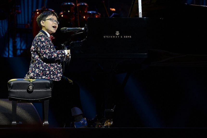 10-year-old Isaiah Hui played his own composition, Joy Of Music, on the piano.