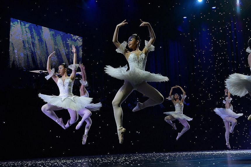 Dancers from the Singapore Ballet Academy performing the snow scene from Russian composer Tchaikovsky's The Nutcracker last night at ChildAid, one of Singapore's biggest charity concerts.