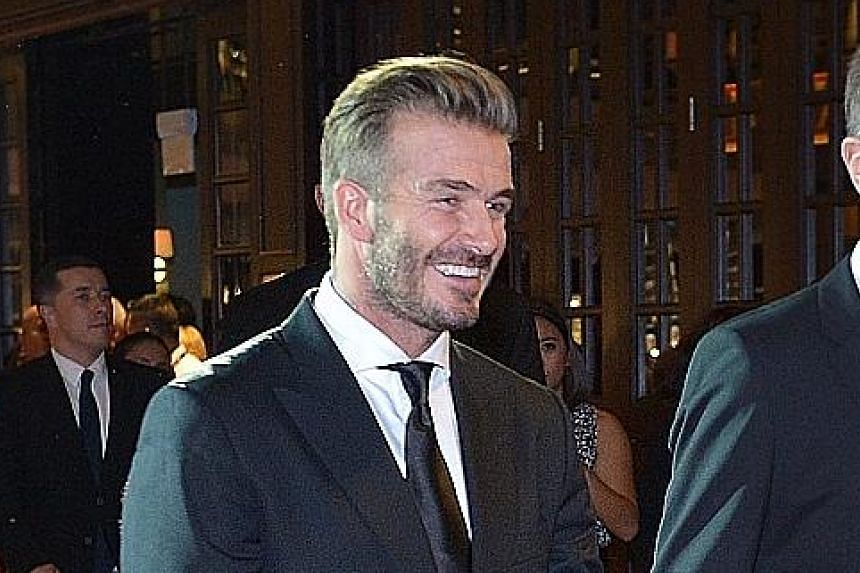 Gladys Ng won the Best Singapore Short Film award for My Father After Dinner, inspired by her foodie father. Former England football star David Beckham was a surprise guest at the Silver Screen Awards last night. A beaming Michelle Yeoh with her Cine