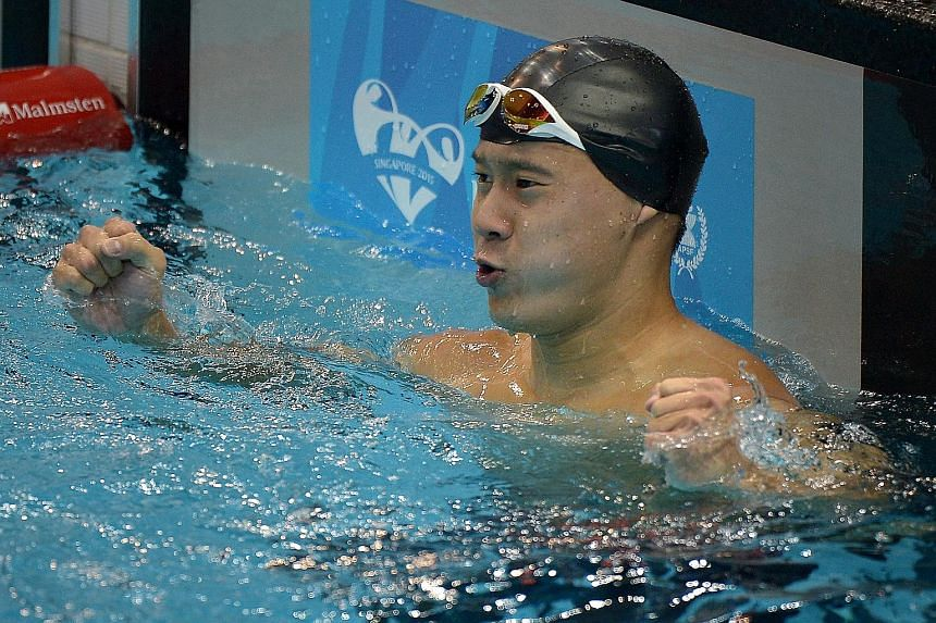 Benson Tan celebrating his win in the 200m freestyle S14 - his second gold after taking the two-lap event earlier. Swimmers have contributed two-thirds of Singapore's 12-gold haul.
