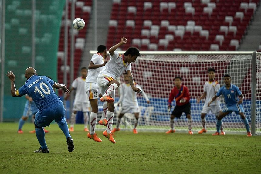 Khairul Anwar Kasmani (left) scoring from a free kick to complete his hat-trick against Myanmar yesterday. The Singapore captain now has four goals to his credit in this Asean Para Games.