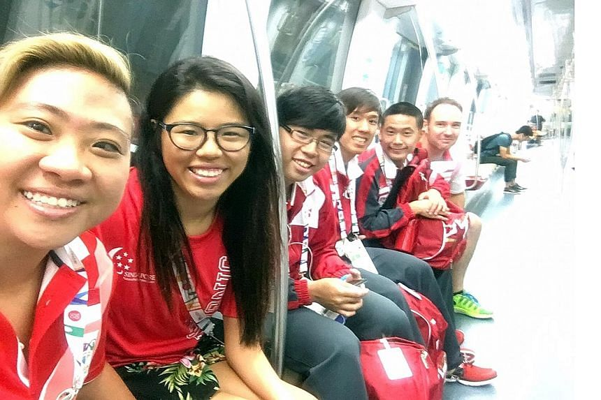 Theresa Goh (left) posing for a photo with Yip Pin Xiu (on her left) and fellow Team Singapore athletes, whom she calls her family.