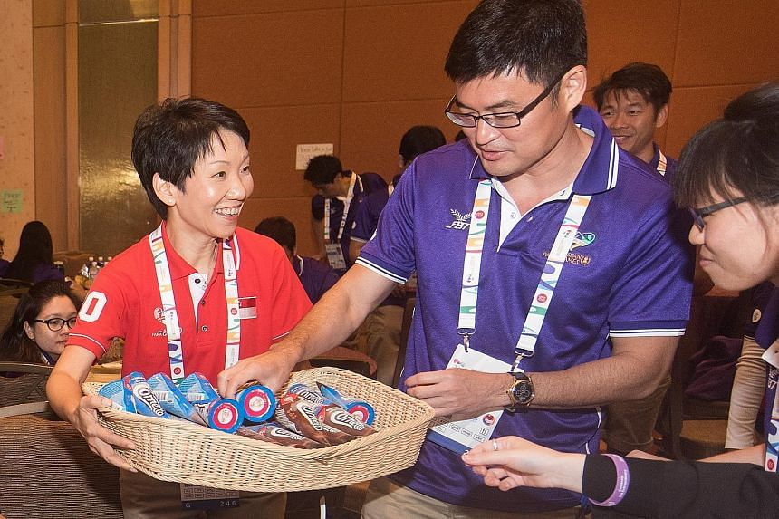 She did not have KitKats to give to volunteers taking a break but Minister for Culture, Community and Youth Grace Fu had a basket full of ice cream to share at Marina Bay Sands. She visited volunteers yesterday - which was also International Voluntee