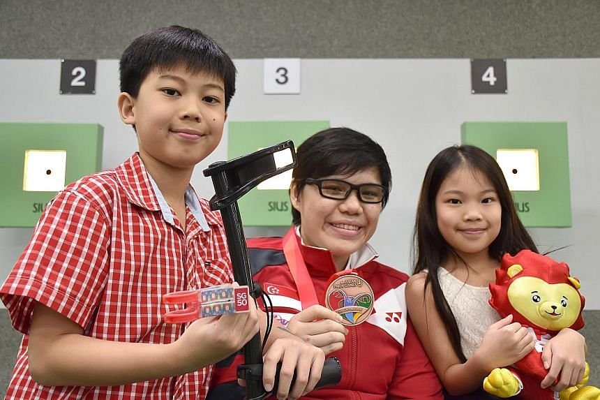 QaneMate is an early Christmas gift from Ian Hao (left) and Ing Le for Neo (centre), who uses a forearm crutch, and it came adorned with an SG50 logo, stickers of Santa Clauses and Christmas trees.