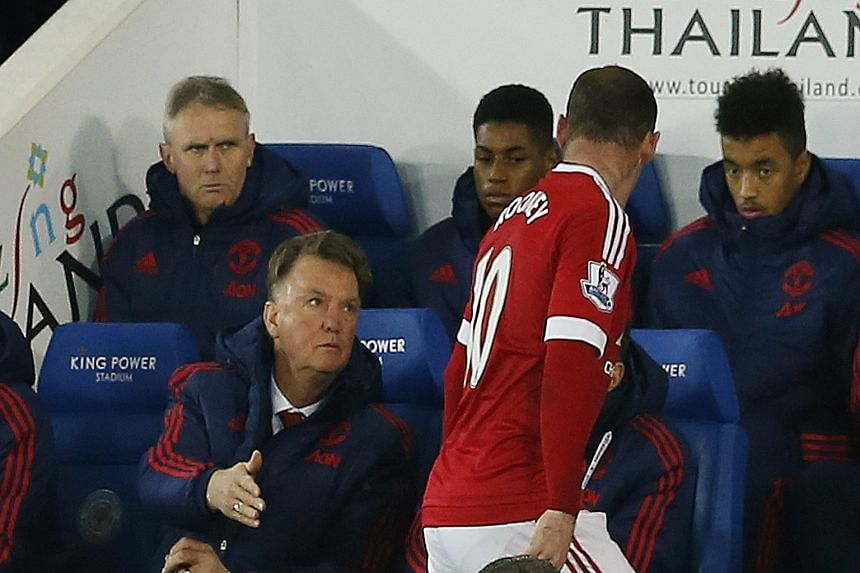 United manager Louis van Gaal shaking hands with Wayne Rooney after the captain was substituted against Leicester the previous week. His regimented style is said to be stifling creativity among the players, with a series of draws upsetting the fans t