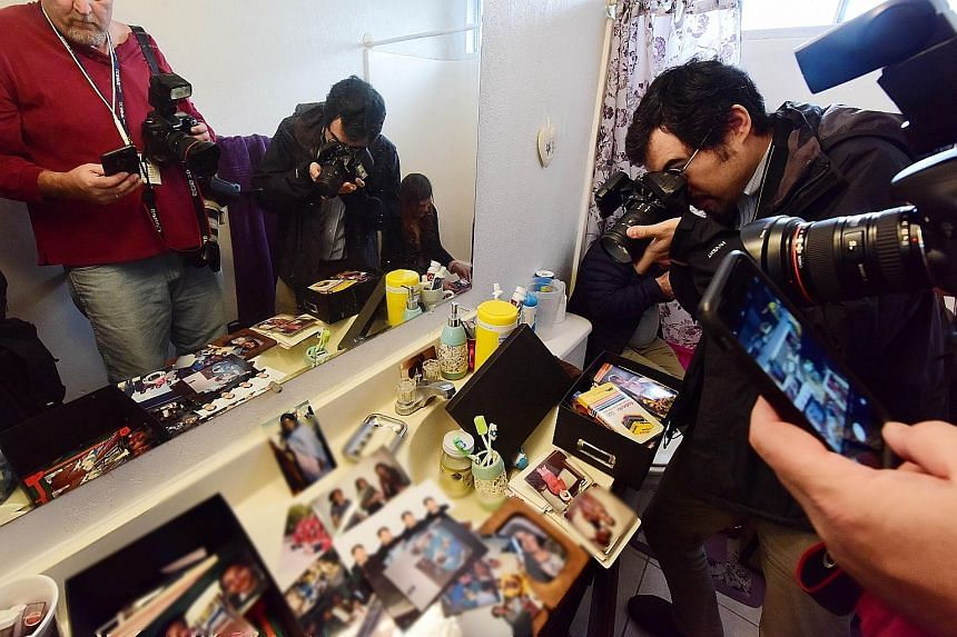 Journalists taking photographs in the bathroom of the Californian home where US citizen Syed Farook and his Pakistani wife Tashfeen Malik lived with their six-month-old daughter. The landlord gave media crews access to the two-storey townhouse on Fri