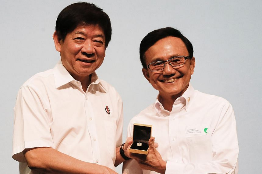 Mr Lim Joo Kwan (right in photo), one of three recipients of the Dedicated Service Star, receiving his award from Coordinating Minister for Infrastructure and Minister for Transport Khaw Boon Wan at the awards ceremony yesterday.