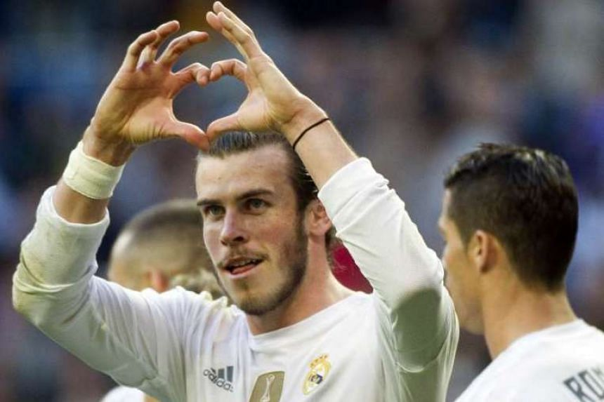 Real Madrid's Welsh forward Gareth Bale gestures as he celebrates a goal.
