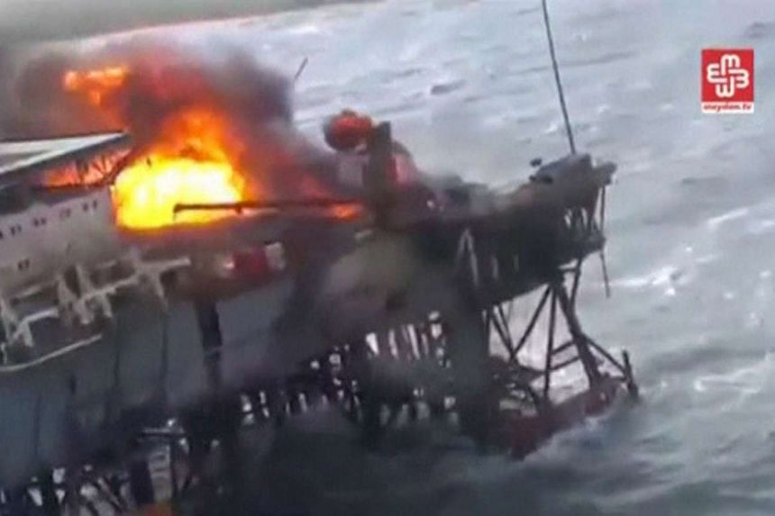 A still image from video footage shows the oil platform on fire in the Caspian Sea.