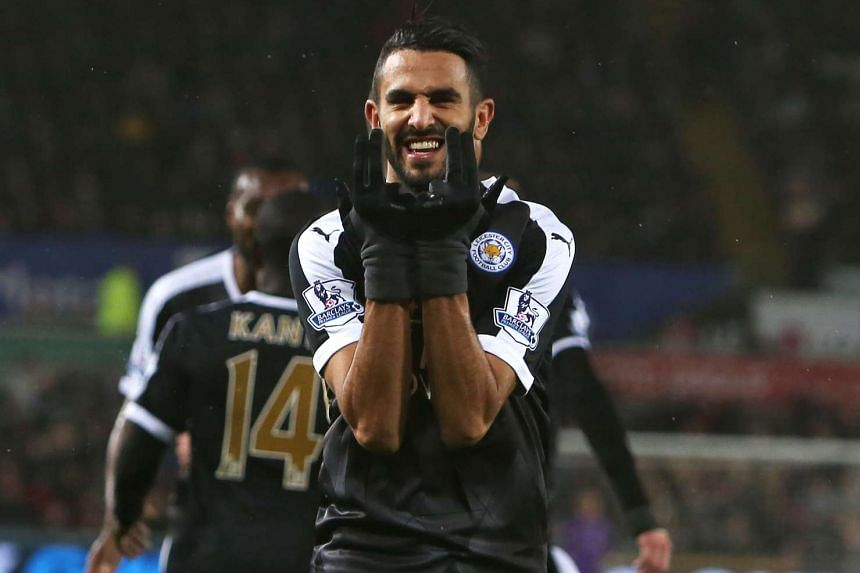 Leicester City's Algerian midfielder Riyad Mahrez celebrates after scoring his third goal.