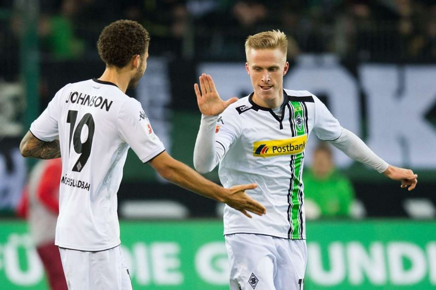 Moenchengladbach's Oscar Wendt (right) celebrates his goal at 1-0 with Fabian Johnson.
