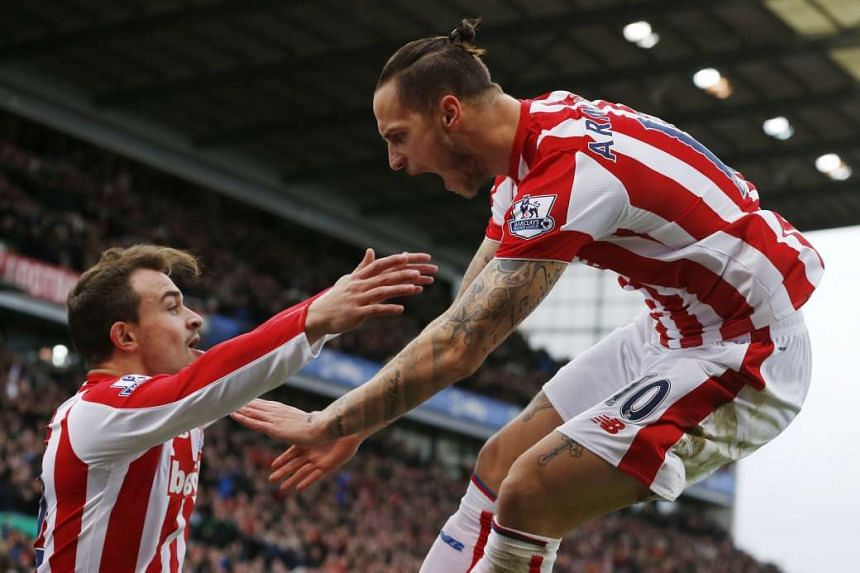 Marko Arnautovic (right) celebrating with Xherdan Shaqiri after scoring the first goal for Stoke City. He netted the second goal as well, again from a Shaqiri assist, as the club clinched their fourth consecutive home victory.