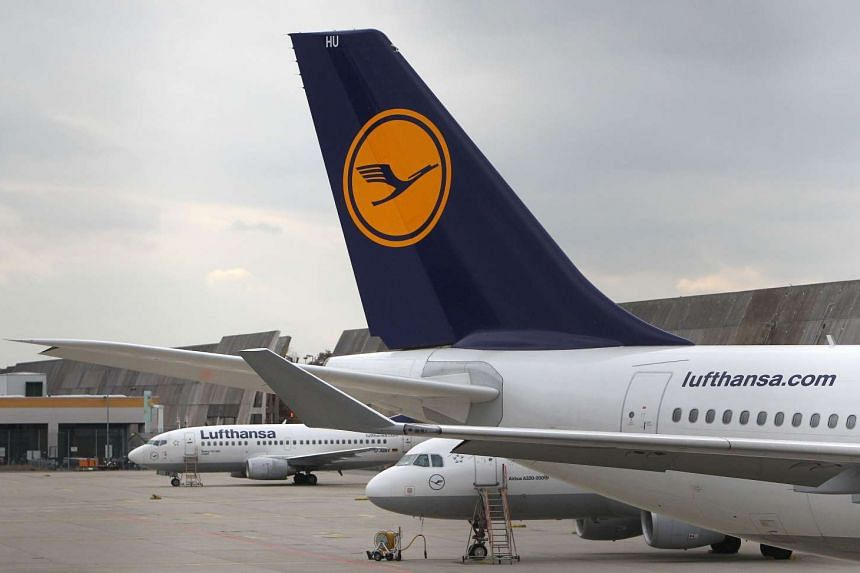 Aircrafts of German airline Lufthansa are parked at the airport in Frankfurt am Main, on Nov 6, 2015