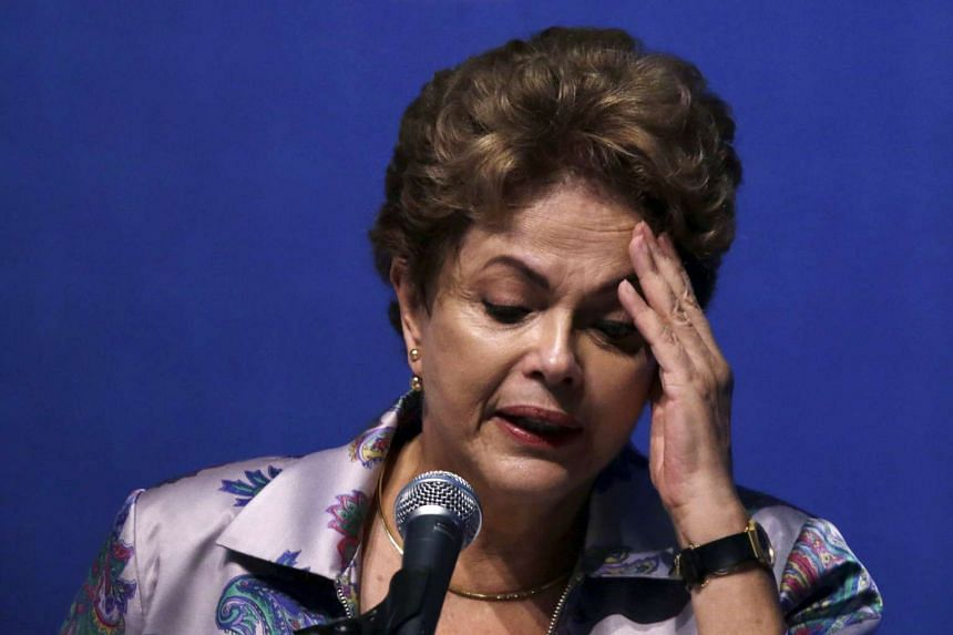 Brazil's President Dilma Rousseff speaks during the 15th National Health Conference in Brasilia, Brazil on Dec 4, 2015. Rousseff suffered two setbacks on Friday to her fight against impeachment, as a minister from her main coalition ally resigned and