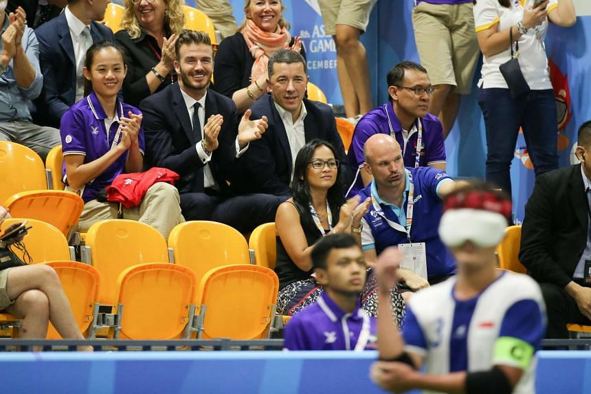 David Beckham watching the five-a-side football match between Singapore and Thailand at the 8th Asean Paralympic Games.
