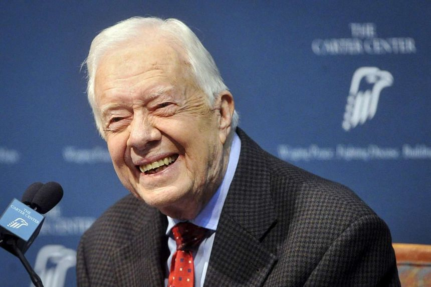 Former US president Jimmy Carter takes questions during a news conference about his cancer diagnosis and treatment plans, in Atlanta, Georgia, on Aug 20, 2015.