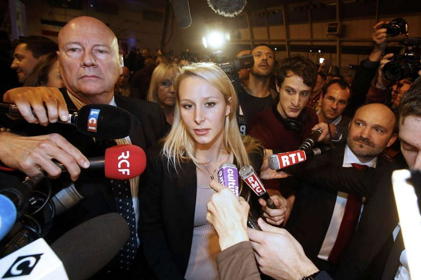 Marion Marechal-Le Pen, French National Front political party member and candidate for National Front in the Provence-Alpes-Cote d'Azur region arrives to deliver her speech after the announcement of the results during the first round of the regional