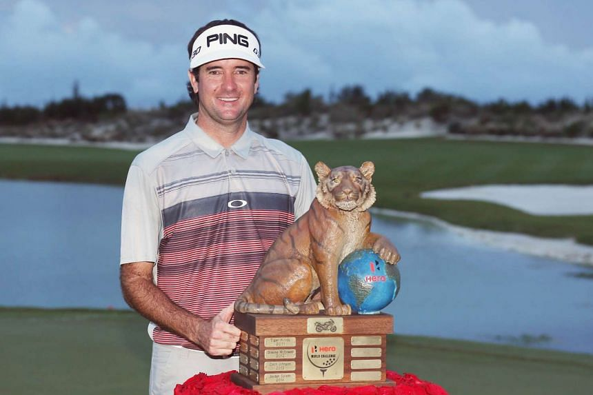 Bubba Watson of the United States poses with the trophy after his three-stroke victory at the Hero World Challenge.