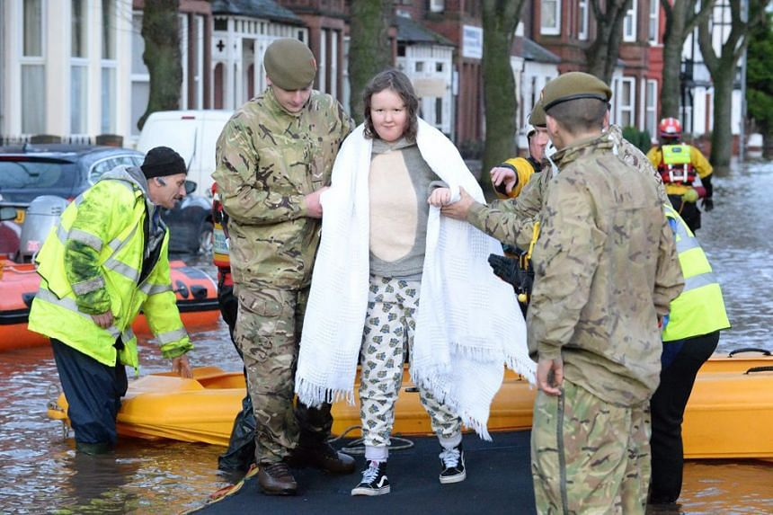 British soldiers from the 1st Battalion, The Duke of Lancaster's Regiment, helping to evacuate residents in north-west England on Dec 6, 2015.