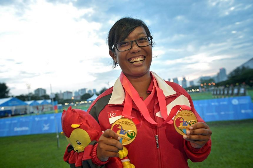 Singapore's Syahidah Alim poses at the victory parade after winning gold at both the the Archery Individual Compound Open (Women) and Mixed Team Compound events.