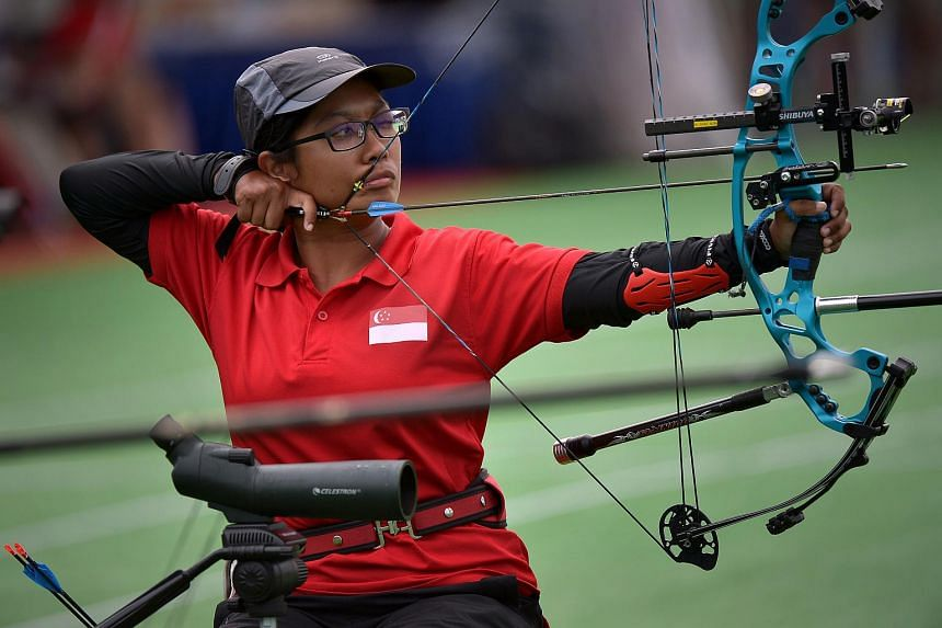 Singapore's Syahidah Alim wins gold at the Archery Individual compound open women's event.