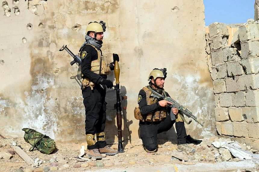 A picture made available on Dec 1, 2015 shows members of the Iraqi armed forces during a military operation in the village of Husaybah, near Ramadi city, 70 km west of Baghdad, Iraq, on Nov 30, 2015.