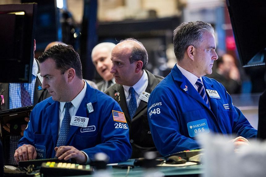 Traders work on the floor of the New York Stock Exchange on Dec 4, 2015, in New York City.