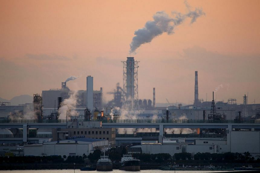 Factories at an industrial zone are seen from Haneda airport in Tokyo.