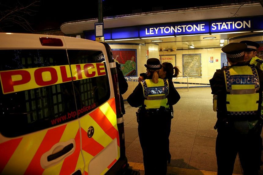 Police officers investigate a crime scene at Leytonstone underground station in east London, Britain on Dec 6, 2015.