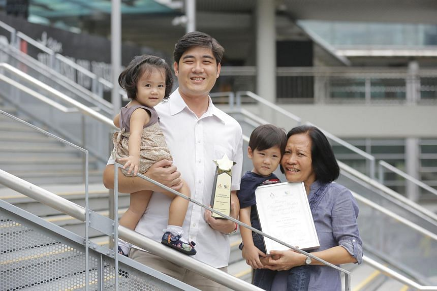 Marny C. Pera (right) nominated her employer Madam Yap Sock Hoe for the Foreign Domestic Worker Employer of the Year Award which she won. Madam Yap's son, Ling Wei Hong (second from left) received the award on his mother's behalf.