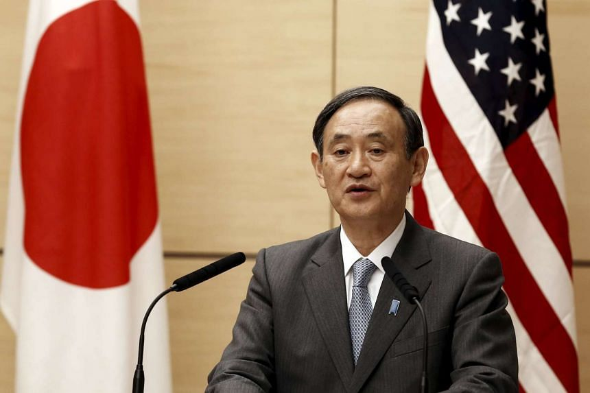 Japan's Chief Cabinet Secretary Yoshihide Suga (above) said that the new unit will focus on gathering and analysing information.