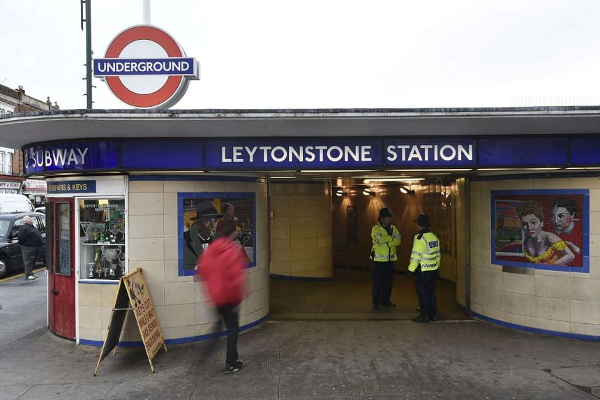 Police officers standing on duty outside Leytonstone Underground station in east London on Dec 7, 2015.