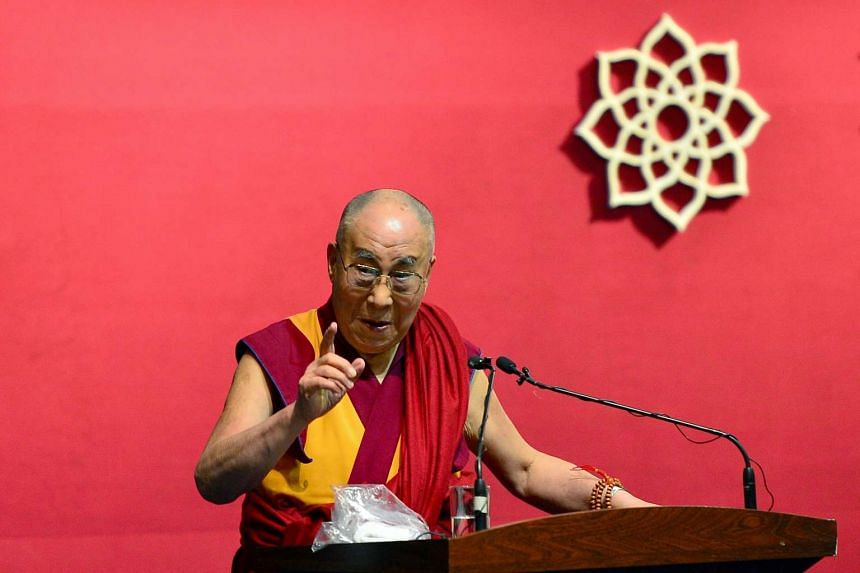 The Dalai Lama gesturing as he speaks during the foundation stone laying ceremony of the Nimhans Integrated Centre for Yoga in Bangalore on Dec 7, 2015.