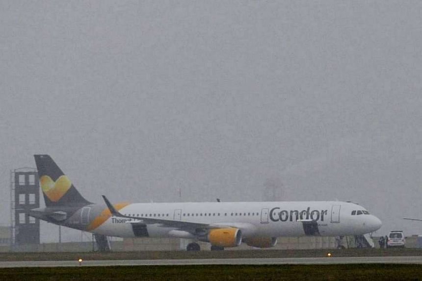 A German Condor Airlines A321 sits on the tarmac at Liszt Ferenc International Airport in Budapest, Hungary, after it was subject to a bomb threat, on Dec 7, 2015.