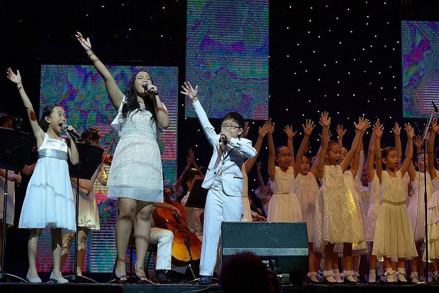 (From far left) Bryzlyn Sin, nine, Nur Liwani Izzati, 16, and Isaiah Hui ,10, sing the theme song, Be The Light, with the CHIJ Kellock Choir, while Jitterbugs Swingapore perform Fosse's World.