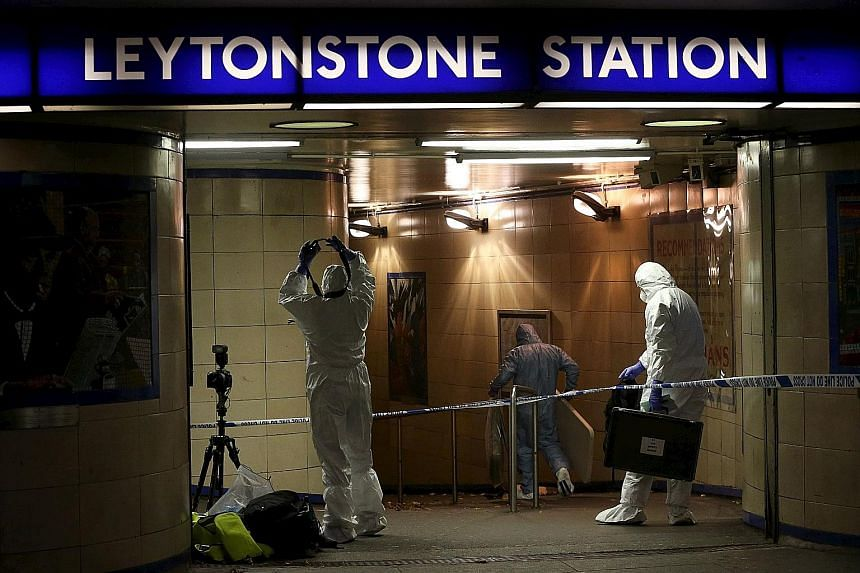 Investigators at the Leytonstone metro station in east London yesterday after a knife-wielding attacker was arrested in an incident that the police are treating as terrorism. A 56-year-old man suffered serious but not life-threatening injuries while