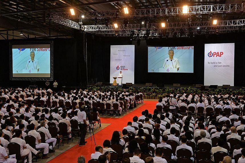 "PM Lee Hsien Loong speaking at the PAP convention yesterday. What will strengthen Singapore further is ""to have Singaporeans doing things together, for one another"", he said."