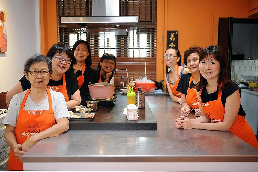 Food Playground co-founder Lena Tan (far right) with staff (from left) Wong Ah Mee, 68, Lesley Lim, 47, Helen Teo, 55, Lydia Soh, 43, Caryn Oh, 34, and Tan Heng, 62.