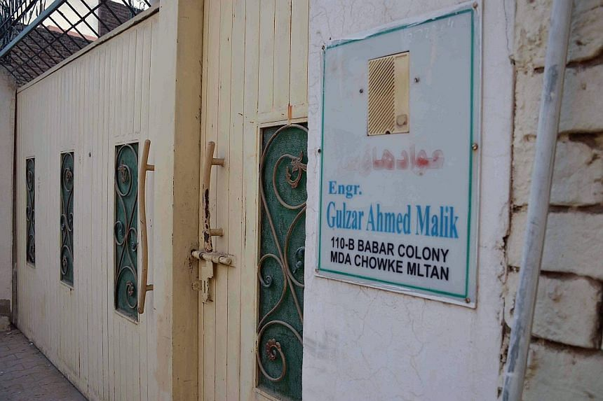 Left: The house where Tashfeen Malik lived during her studies in Pakistan. Above: Malik's Pakistan identification card.